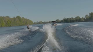 Extreme Sport - Wake Board rider doing tricks behind the boat