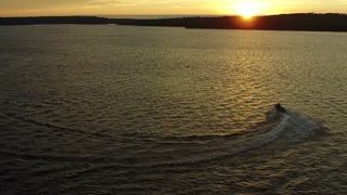 Golden View of Jet Ski on Water