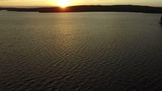 Jet Ski riding off into the sun set