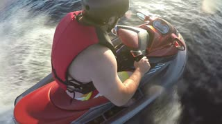 Jet Ski Seadoo rider racing around the lake on his pleasure craft