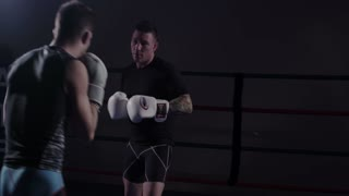 Mixed Martial Arts - Fighter Blocking Punches