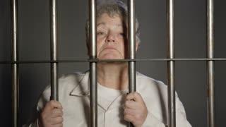 Modern Prison - People in Jail for Crimes - Elderly Woman behind bars