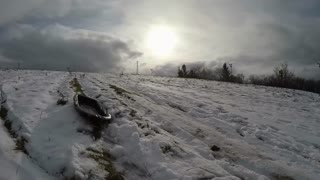 Passing Sled On Snowy Hill