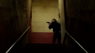 Police Officer In Sketchy Hallway With Gun
