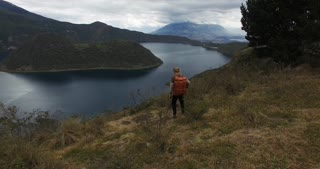 Traveller backpacking through ecuador - collapsed volcano crater