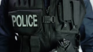 Two hands on police body camera