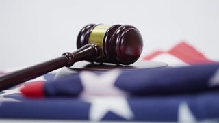 American Justice Gavel and USA flag on white background