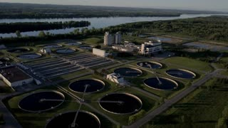Aerial of sewage waste water treatment facility at golden hour