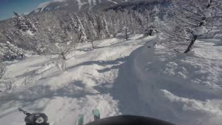 Back country ski with deep powder and blue sky