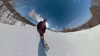 Black athlete skiing on the slopes in snow park