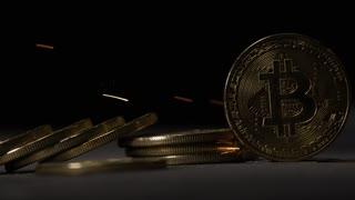 Black token background sparks slow motion bitcoin