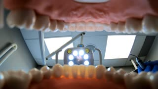 Dental tools from inside mouth at dentist office checkup