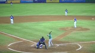 Dominican Baseball Player Throwing Strike On A Bunt