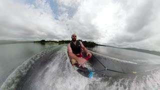 Extreme sports Wakeboard unique angle behind boat