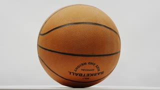 Fast Spinning Basketball On White Screen