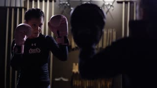 Female fighter throwing punches in slow motion