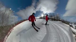 Female skier doing tricks in the snow
