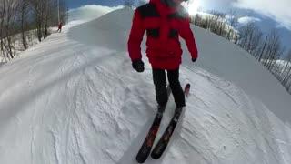 Female skier slide box to 180 spin