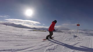 Female snowboarding slow motion grind