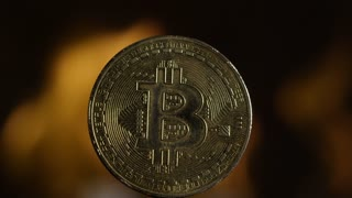 Full speed bitcoin burning in front of black background