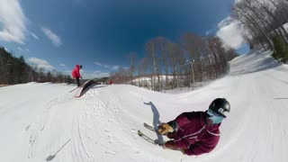 Group of friends ripping the snow park on a ski hill doing extreme tricks 1