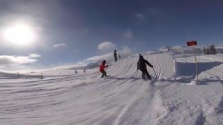 Ladies skiing in the snow park big jump tricks