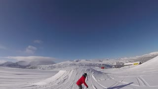 Lady snowboarder big jump and grab on blue sky