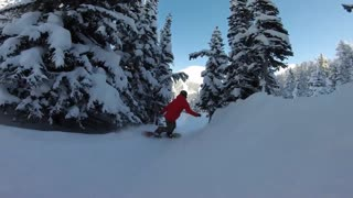 Lady snowboarder slow motion back country lines