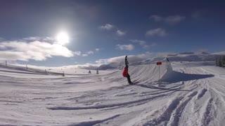 Male rider doing big 360 on snow jump ski snowboard