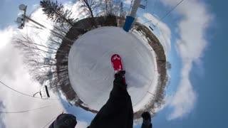 Man snowboarding down ski hill