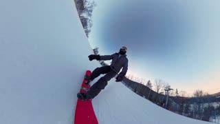 Man snowboarding down winter ski hill