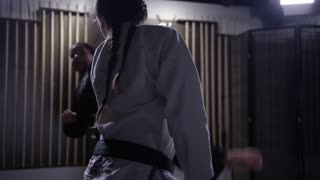 Martial arts athletes takedown in slow motion female athlete