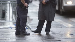 NYPD on streets of New York on rainy day