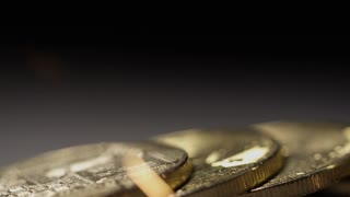 Panning shot of coins slow motion sparks bitcoin