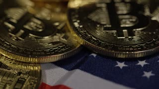 Rack focus macro on bitcoins with american flag