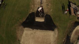 Slow motion 360 aerial birds eye view bmx bike jump