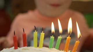 Slow Motion Blowing Out Candles On Birthday Cake