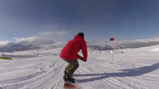 Snowboarder lady doing tricks on the hill