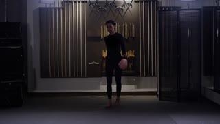 Tough girl walking towards camera in dojo martial arts