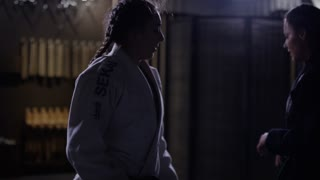 Women preparing for fight in dojo