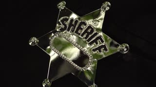 Western Historical Re-enactment - Taking Sheriff Badge Close up
