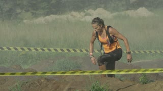 Young Woman Running an Adventure Race