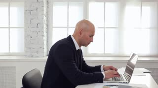 Businessman Writes a Letter/Businessman typing on a laptop