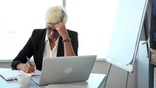 Businesswoman in Stress in the Workplace