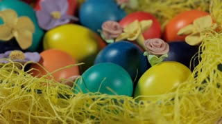 Colourful Easter eggs in a basket.