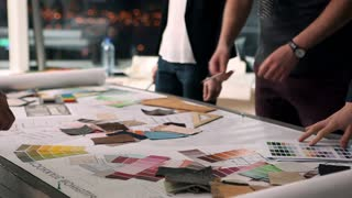 Designers at Work/A group of young designers led by the head are working on the project of design business center, private home, studio, shop, office
