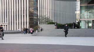 EDITORIAL: Crowd of people in Paris, La Defence. Timelapse