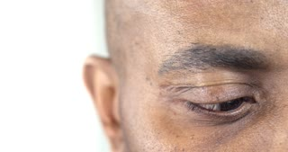 Extreme Close-Up of a Brown Eye of an Afro-American Man