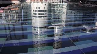 Reflections of buildings in water. Paris, La Defense. Long shot (Reflections of Buildings in Water)