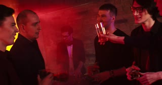 Bachelor's Party at a Nightclub. Guys are talking and drinking whisky at a nightclub. One of them is going to marry soon